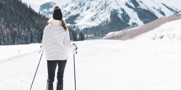 woman cross country skiing in black obermeyer pants