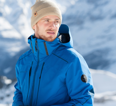 man in blue obermeyer jacket