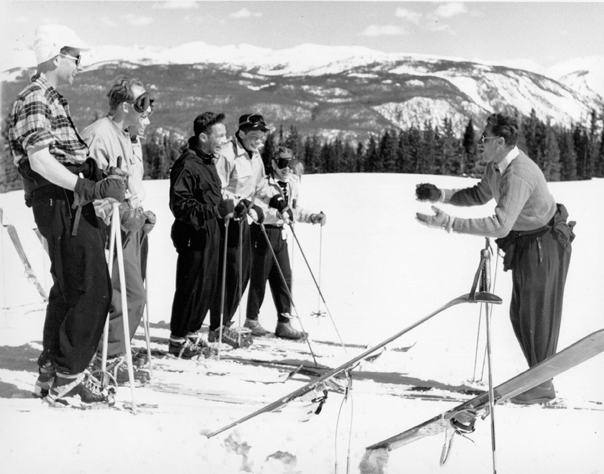 historic photo of klaus teaching ski school