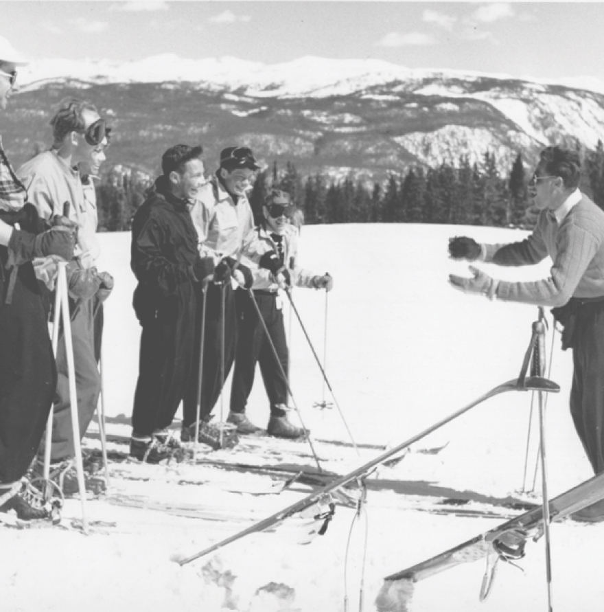 historic photo of klaus teaching skiing